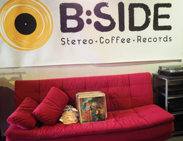 The red couch at B Side Stereo in Tel Aviv is a spot to find friends and the local street cat who likes to beg for pets