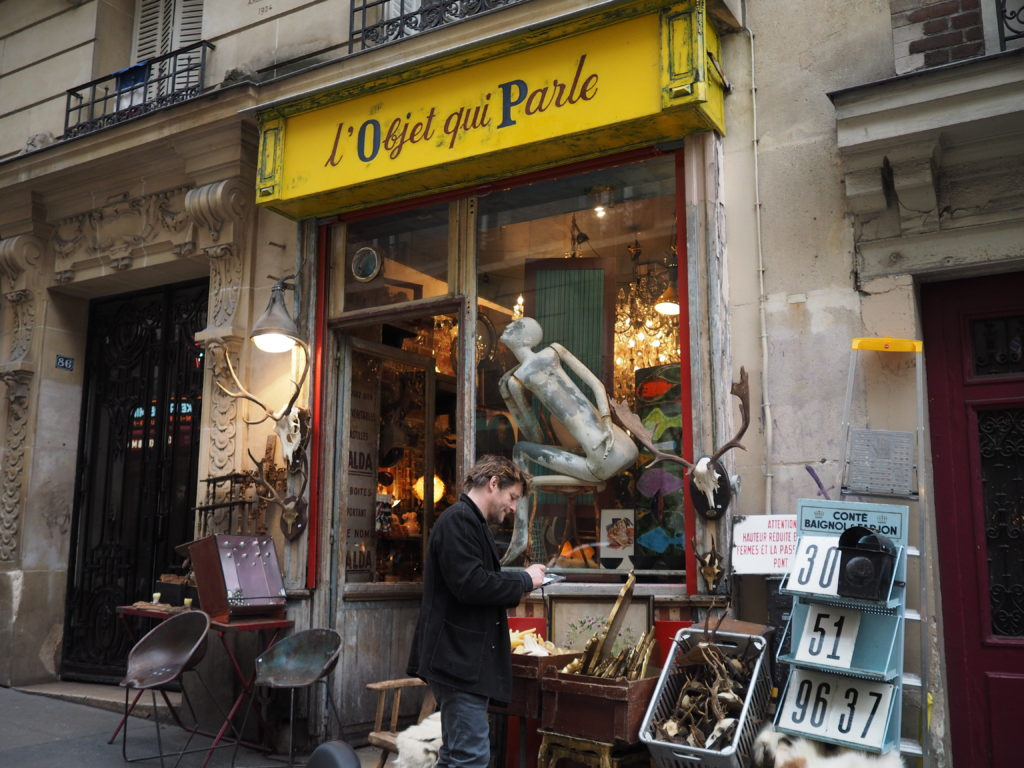 Exterior of small antiques and oddities shop in Montmartre Paris named L'objet Qui Parle