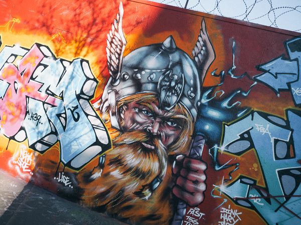 Norse Warrior with long red beard and winged helmet in Montmartre by Unidentified Street Art Crew - Paris Street Art