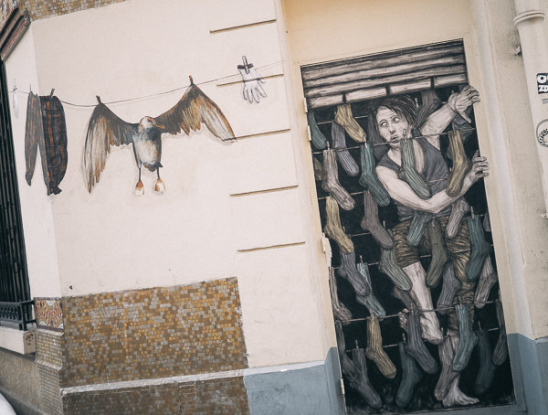 "Part of a Paris Street Art Collaboration Between Artists Levalet and Philippe Hérard called ""Comes and Goes"""