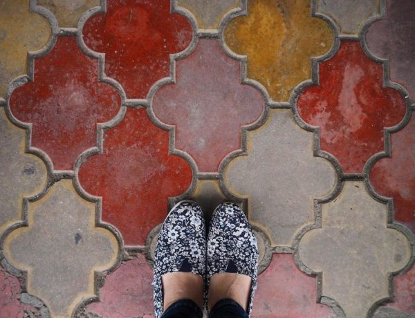 the truth about traveling solo - shoes on colorful tiles in Romania